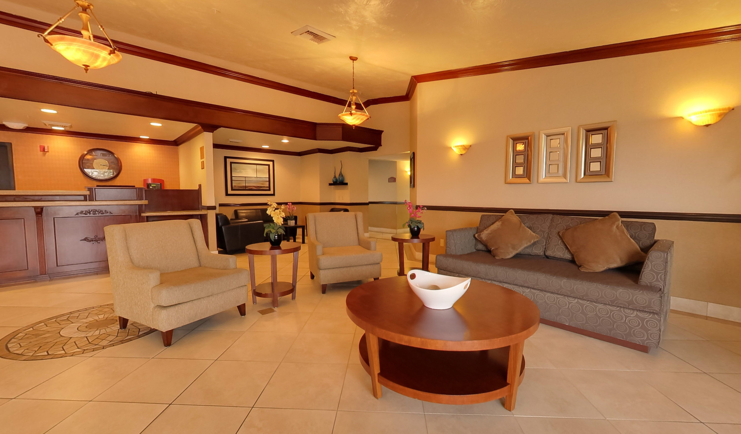 Elegant lobby of Best Western Plus Hotel Las Vegas, with a cozy waiting area facing the reception desk