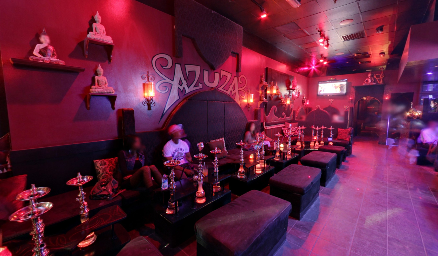 Dark & Egyptian inspired lounge with a couple of patrons inside a hookah bar in Las Vegas - Azuza Hookah Lounge & Cafe