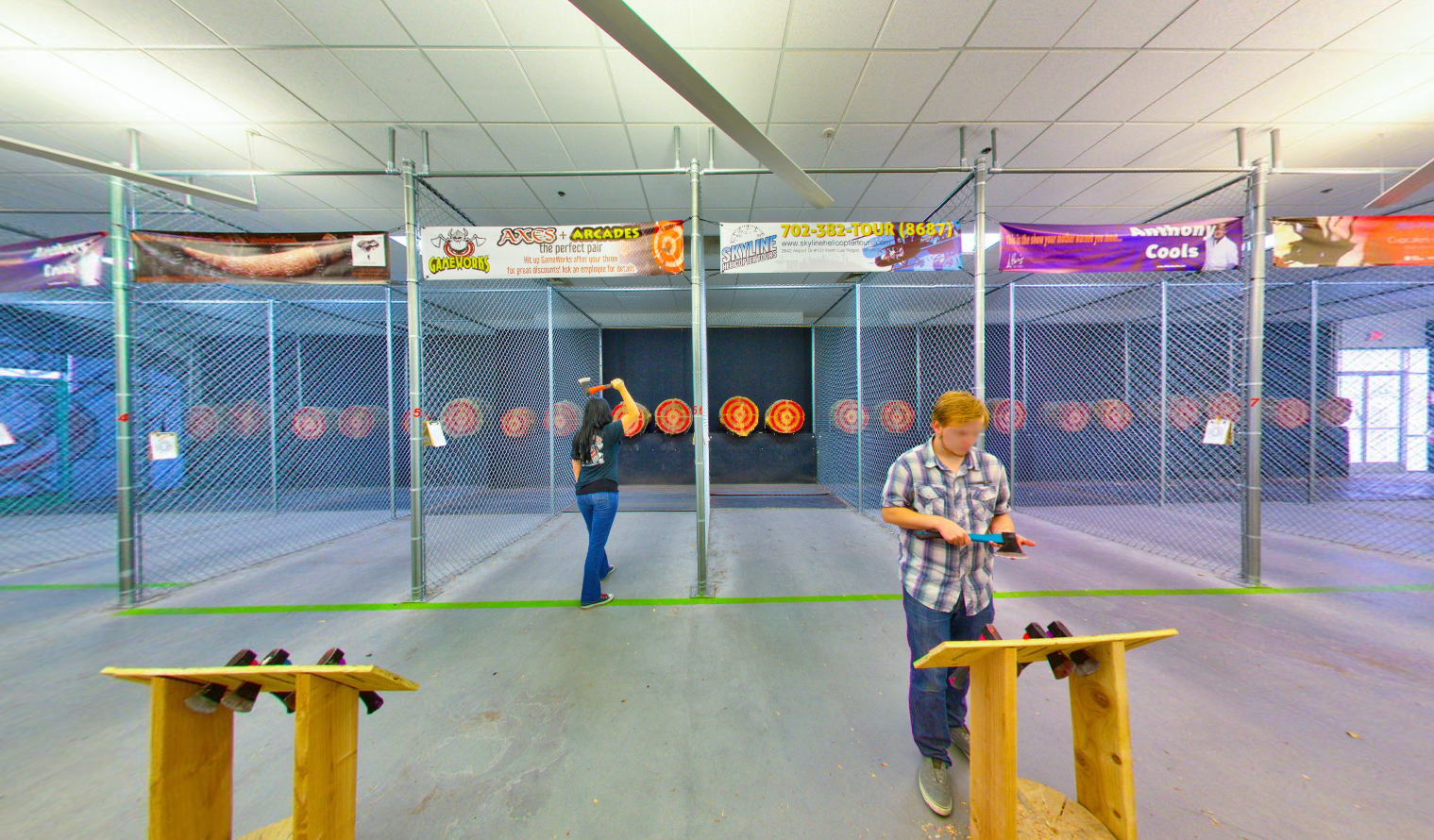 Two players in the activity area of Axe Monkeys - a sports complex in Nevada with indoor axe throwing facility