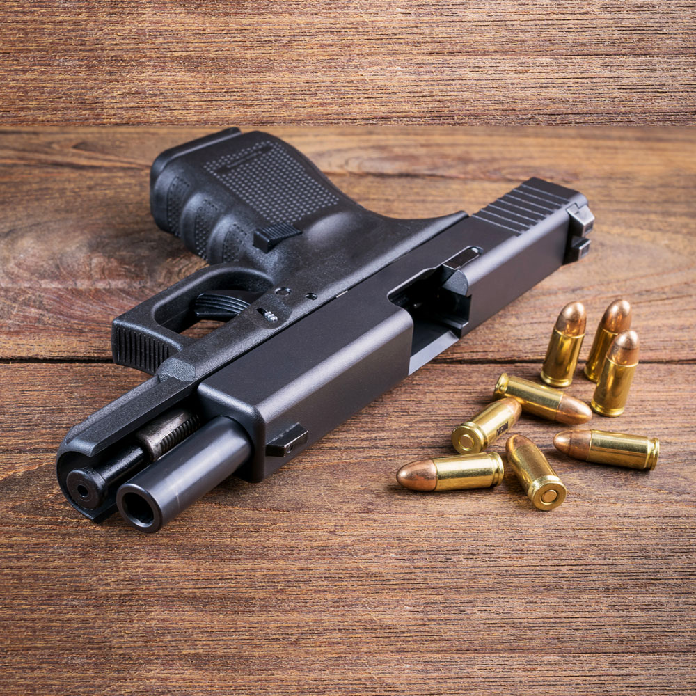 Gun and bullets display in a gun shop.