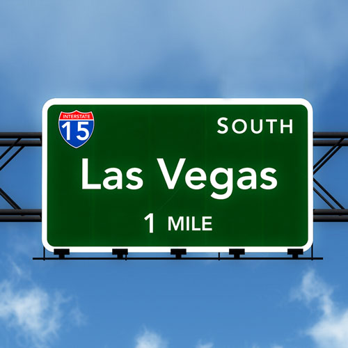 Road signage that says South of Las Vegas can be reached in 1 mile