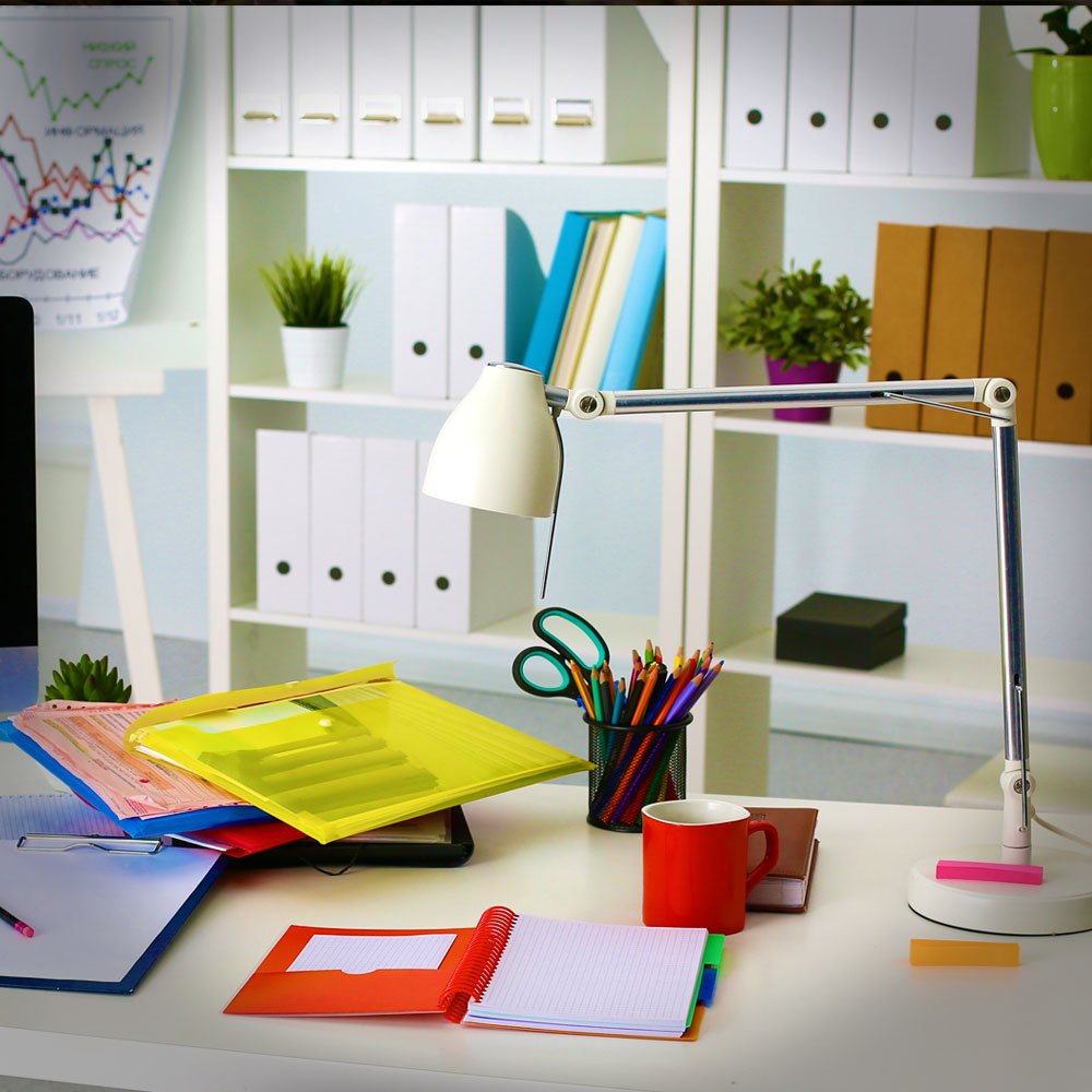 Office setup with different kinds of home and office supplies.
