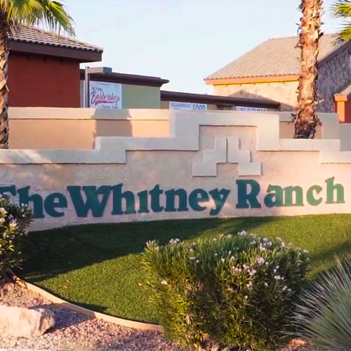 """A concrete signage with """"The Whitney Ranch"""" texts"""