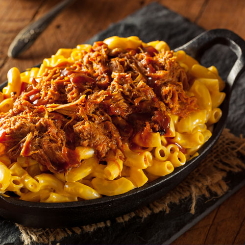Penne pasta with shredded meat toppings served for lunch