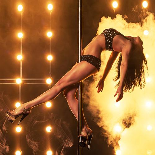 Showgirl doing pole dancing for  pub crawlers around Nevada Strip
