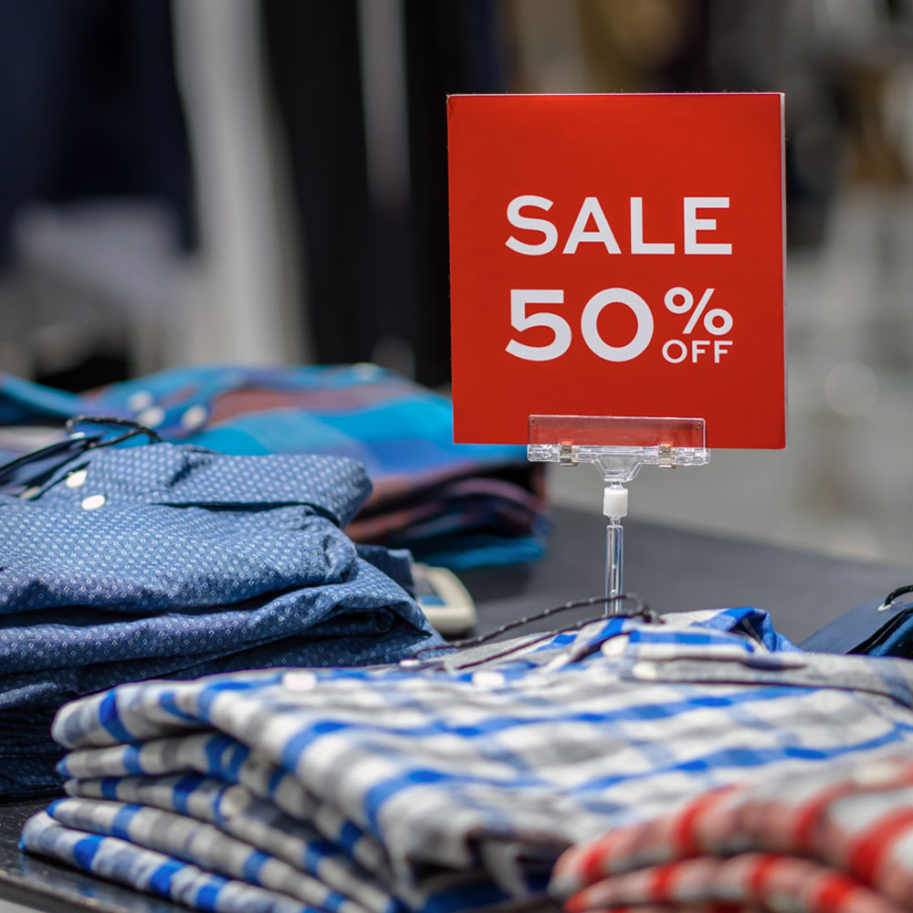 Stack of clothes on sale at a shopping outlet display