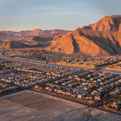 Aerial shot of houses in Northwest Las Vegas with the mountain backdrop