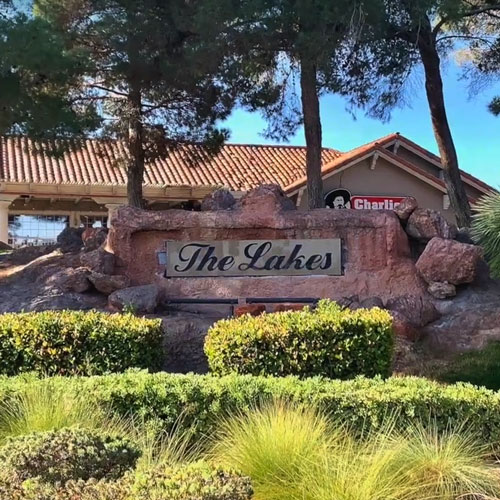 """A concrete signage with """" The Lakes"""" texts"""