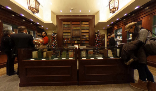 Several book lovers roaming around the huge bookshelves with rare book collections at Bauman Rare Books, Las Vegas NV