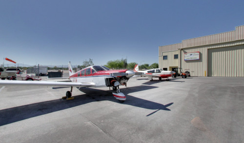 Helicopters of 702 Helicopter Inc parked in the airport apron in Las Vegas.