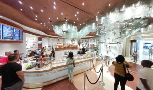 Aria Patisserie - a French bakery in Las Vegas, with customers waiting their orders at the counter